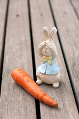 Wood rabbit with fresh carrot