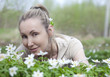 beautiful woman in field of blossoming snowdrops in spring