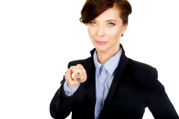 Businesswoman pointing on you with pencil.