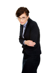 Businesswoman suffering from stomach pain.