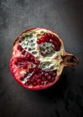 Luxurious pomegranate background. Pomegranate core on black back
