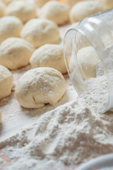fresh homemade dough floured wooden board