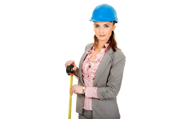 Engineer woman holding tape measure in hand.