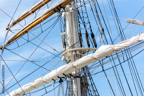 sailboat masts, rigging and rolled up sails