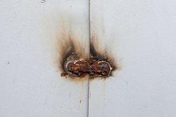 rusty welding lock on the metal gray  gate