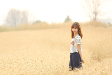 Young woman in wheat