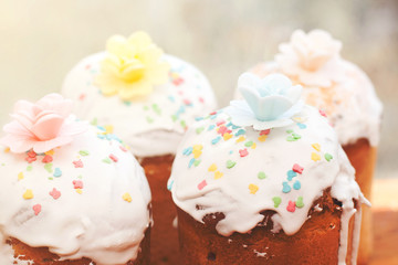Cakes glazed with colored figures of animals and flower
