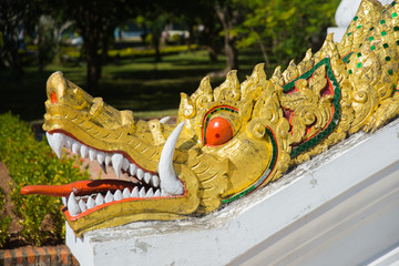 The Golden fragment of decoration of the temple, dragon