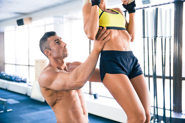 Sporty woman pull-up in gym