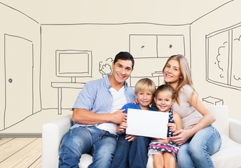 Son. Smiling Parents With Children Sitting On Couch Showing