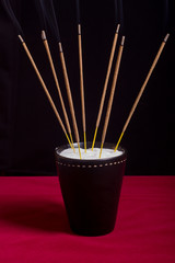 aromatic sticks in black cup