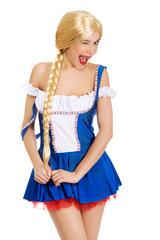 Woman in Bavarian dress blink eye.