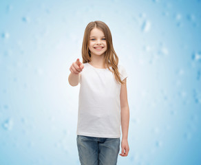 little girl in blank white t-shirt pointing at you