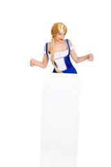 Woman wearing Bavarian dress holding empty banner.