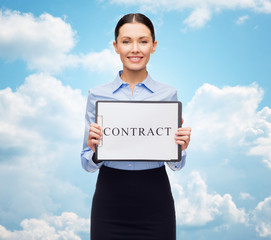 smiling businesswoman with contract