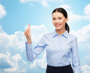 businesswoman touching something imaginary