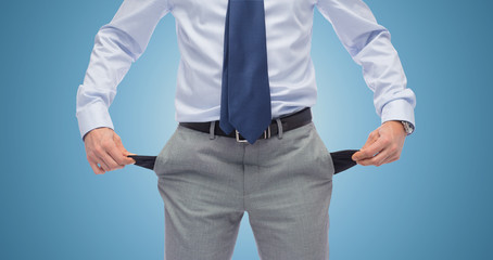 close up of businessman showing empty pockets