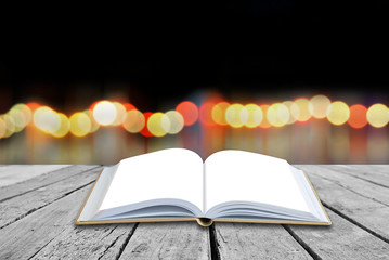 Open blank book with twilight background