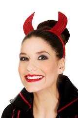 Woman in devil carnival costume.