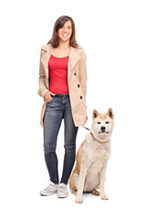 Full length portrait of a young girl posing with dog