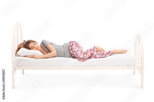 Beautiful brunette woman sleeping in a bed - 81936837