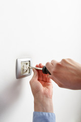 Electrician installing a light switch