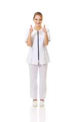 Medical nurse woman with thumbs up.
