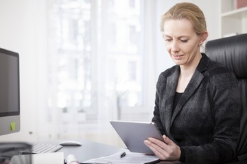 Businesswoman at her Office Using Tablet Computer
