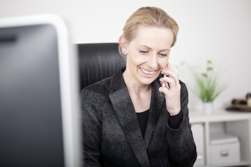 Happy Businesswoman Talking to Someone on Phone