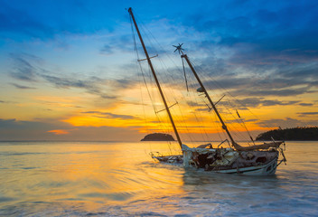 Boat and Yacht abandoned with a beautiful sunset in the east of