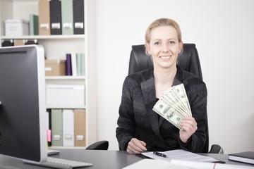Sitting Manageress Showing US Dollar Paper Bills