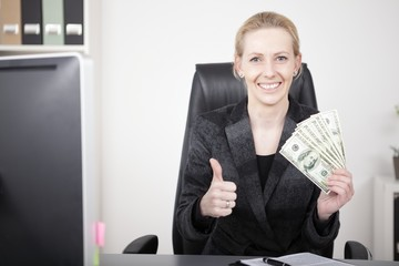 Businesswoman with Cash Showing Thumbs Up