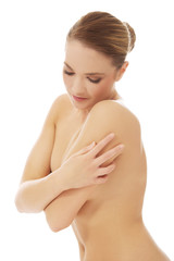 Beautiful spa woman covering her breast.