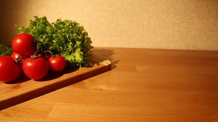A set of vegetables on a cutting board dolly shot right to left