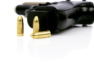 gun and bullets isolated on white