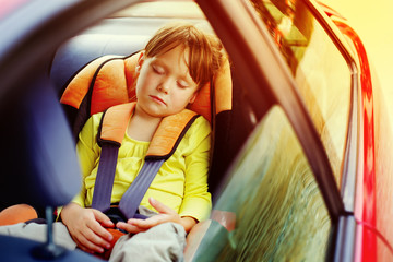 small girl sleeps in car