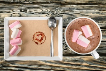 Hot. Red mugs with hot chocolate and marshmallows