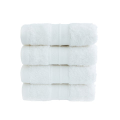 Four white bath towels in stack isolated over white