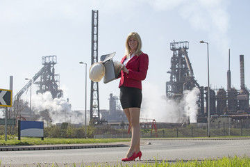 Portrait of Businesswoman with industrial background