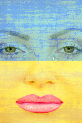 Pretty woman face with tear on Ukranian flag background.
