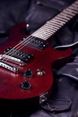 Electric guitar on black leather