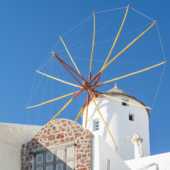 white mill in a sky on Santorini in Greece