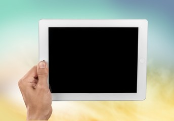 Ipad. Holding and showing digital tablet