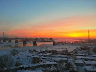 sunrise over the river near the railway bridge