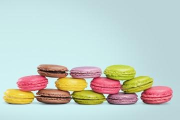 Cakes. Pyramid of pastel macaroons on white background