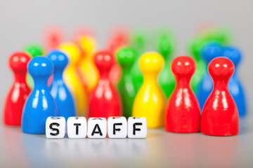 Cube Letters show staff  in front of unsharp ludo figures