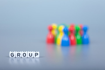 Cube Letters show Group  in front of unsharp ludo figures