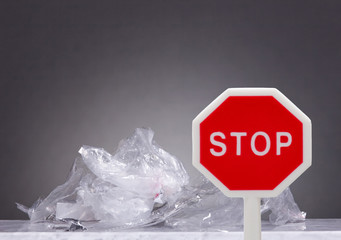 Plastic garbage with stop sign