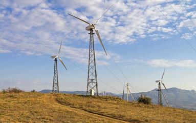 Three wind turbines on a wind farm. Crimea.