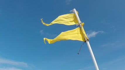 Yellow beach flag warning
